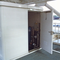 "The ""shed\"" housing the water tank and reverse osmosis equipment"